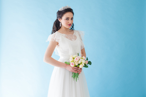 674214372 istock photo Princess Bride in a white dress with a Crown on a blue background 674213686