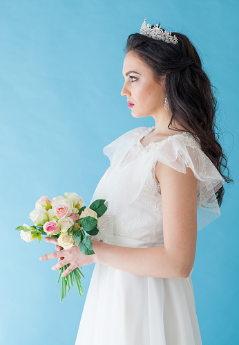 674214372 istock photo Princess Bride in a white dress with a Crown on a blue background 674213872