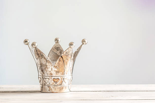 Princess crown on a wooden table - Photo
