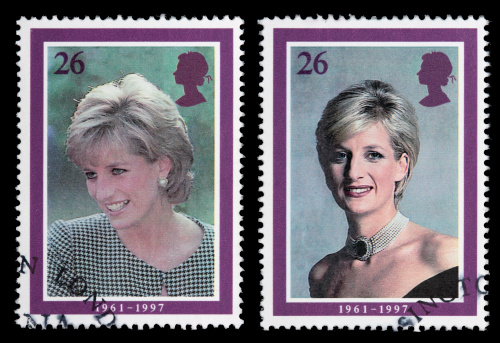 Sacramento, California, USA - April 12, 2008:  Two 1998 Great Britain postage stamps designed by Barry Robinson with portraits of Princess Diana, part of a series of five such stamps issued to commemorate her life. The portrait with Diana wearing a black dress was taken by photographer Lord Snowdon in May 1997; the one where she is wearing a checkered top was taken by Tim Graham in October 1995.