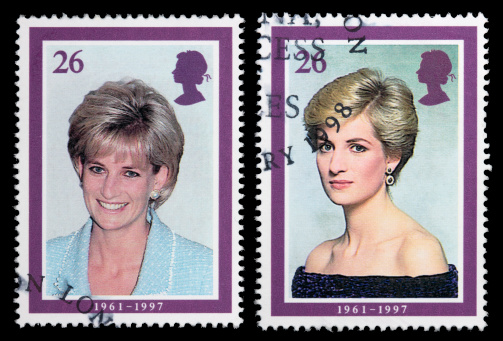 Sacramento, California, USA - April 12, 2008: Two 1998 Great Britain postage stamps designed by Barry Robinson with portraits of Princess Diana, issued to commemorate her life. The portrait with Diana wearing a black dress was taken by photographer Terence Donovan in 1987; the one where she is wearing blue was taken by Jon Stillwell in April 1997.