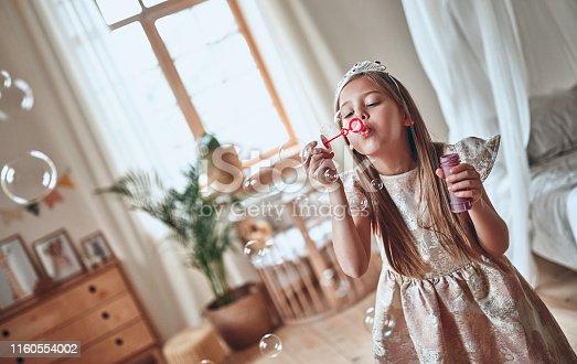 istock Princess girl at home 1160554002