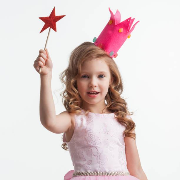 Princess girl with star magic wand stock photo
