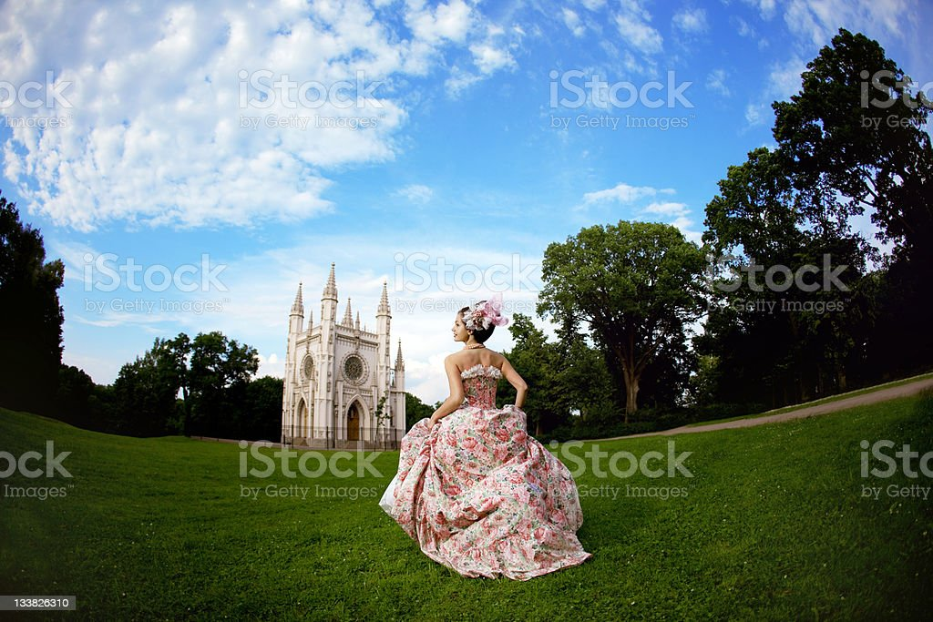 Princess in an vintage dress before the magic castle royalty-free stock photo