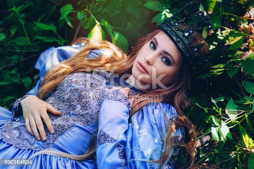 578573556istockphoto Princess in magic forest 590164804