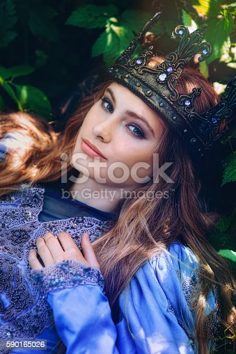 578573556istockphoto Princess in magic forest 590165026