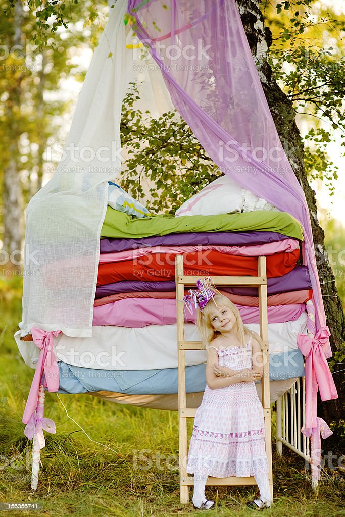 princess near a bed royalty-free stock photo