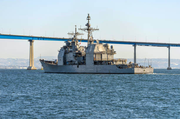 USS Princeton at San Diego Bay - The guided-missile cruiser USS Princeton (CG 59) is sailing towards Coronado Bridge at its homeport of Naval Base in San Diego Bay, San Diego, California, USA. San Diego, California, USA - January 26, 2018: The guided-missile cruiser USS Princeton (CG 59) is sailing towards Coronado Bridge at its homeport of Naval Base in San Diego Bay. naval base stock pictures, royalty-free photos & images