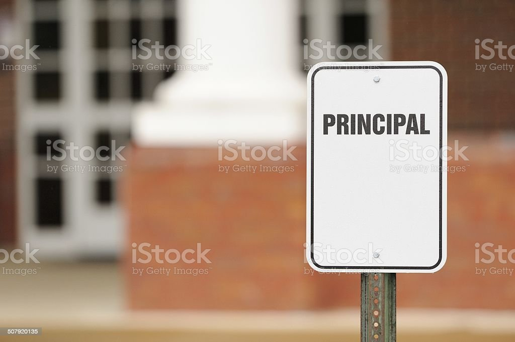 Principal sign for parking in front of school building stock photo