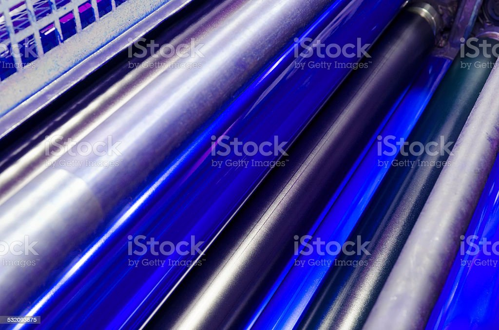 print machine printing press rollers, cyan color drum stock photo