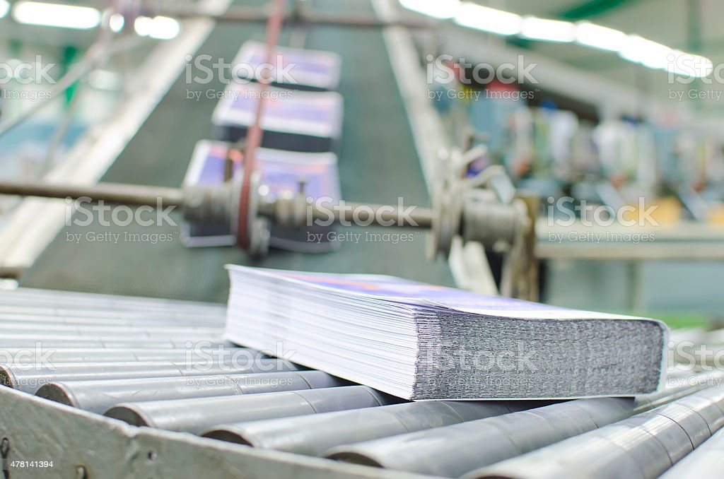 Print shop (press printing) - Finishing line stock photo