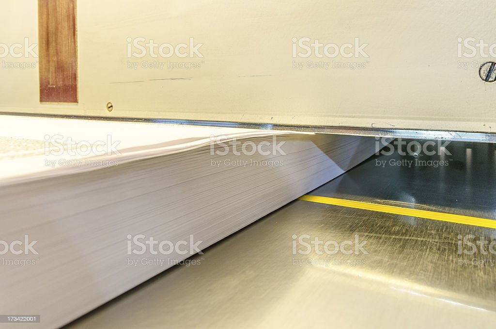 Print shop modern guillotine machine for paper trimming stock photo