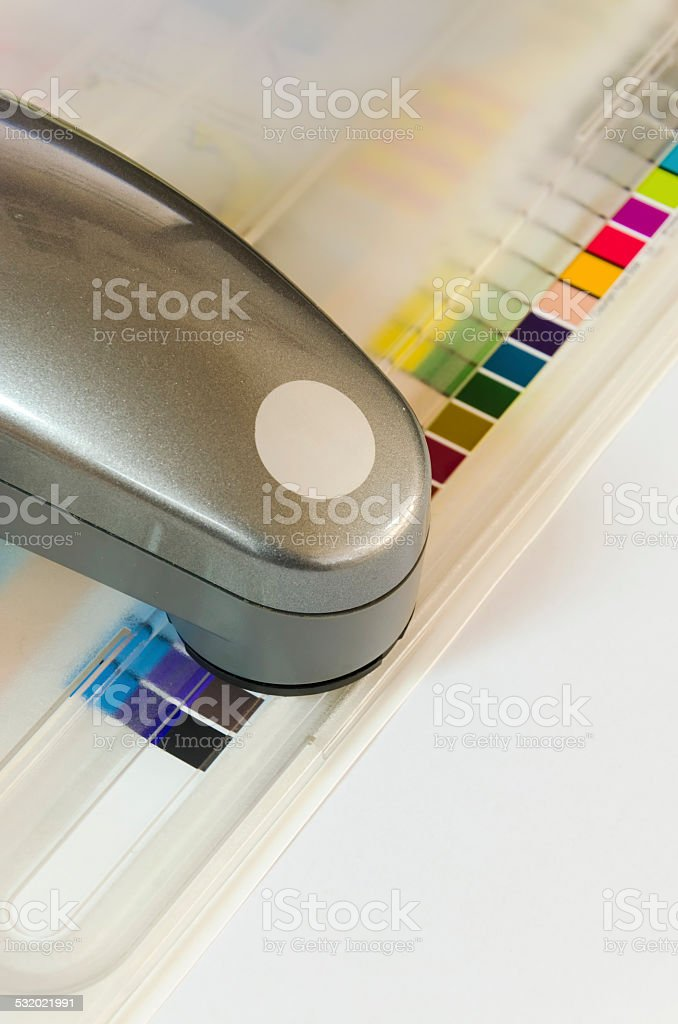 Print Spectrophotometer on Chart color control measurement, vertical stock photo