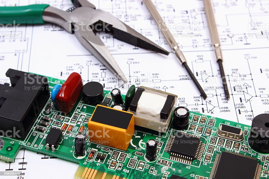 printed circuit board and precision tools on diagram of electronics rh istockphoto com