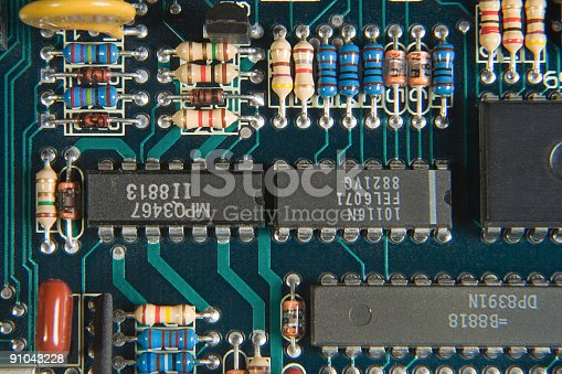 Old printed circuit board with discrete components.