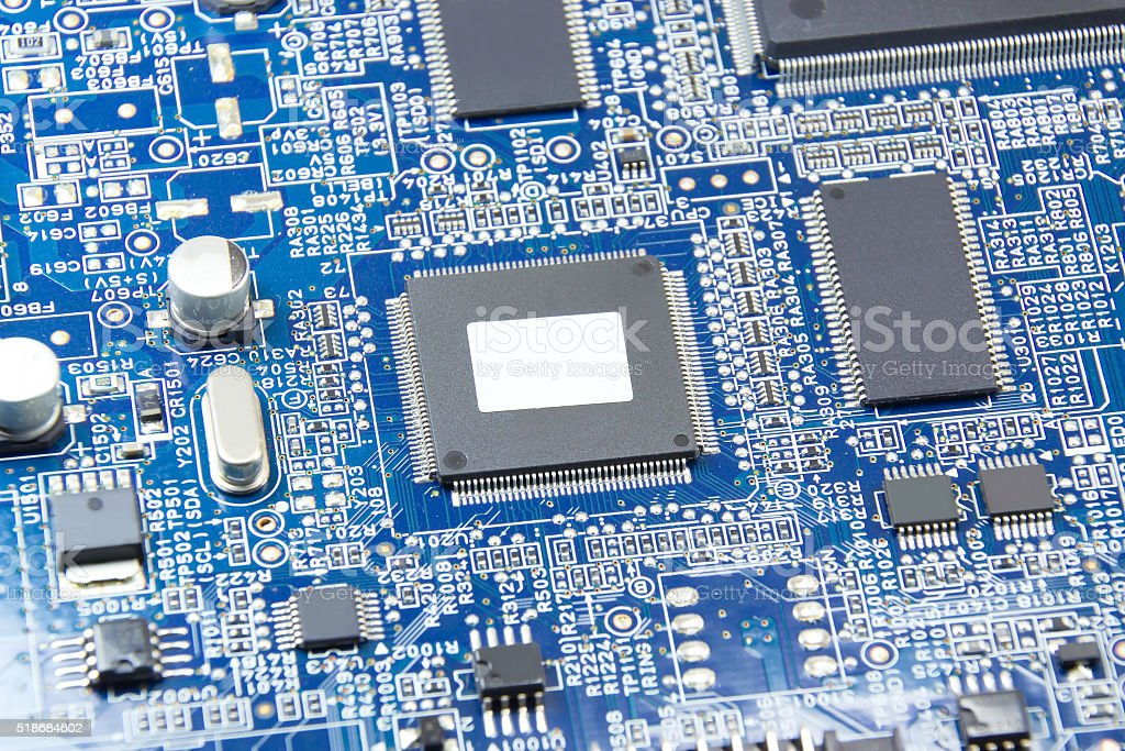 Printed circuit board with electronics components stock photo