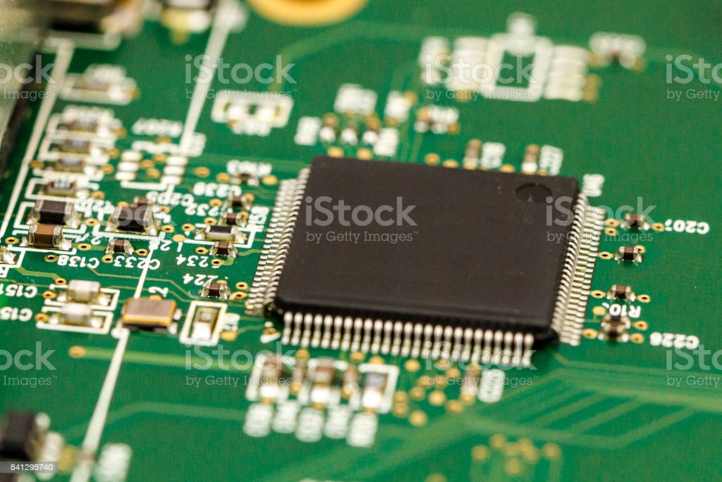 Printed circuit board with ICs, chip capacitors, and chip resistors. stock photo