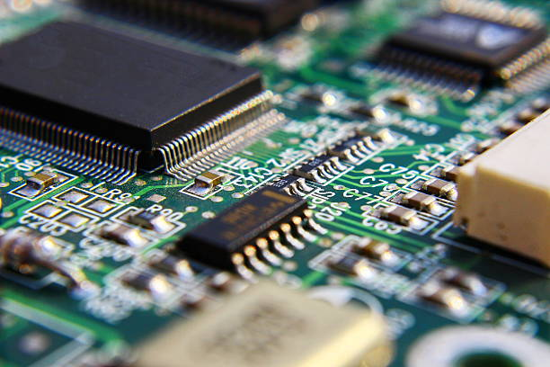 printed circuit components. - mother board stock photos and pictures