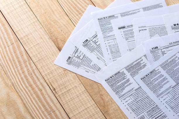 printed form 1120 w 4 on paper - close up printed form 1120 on paper - close up letter w stock pictures, royalty-free photos & images