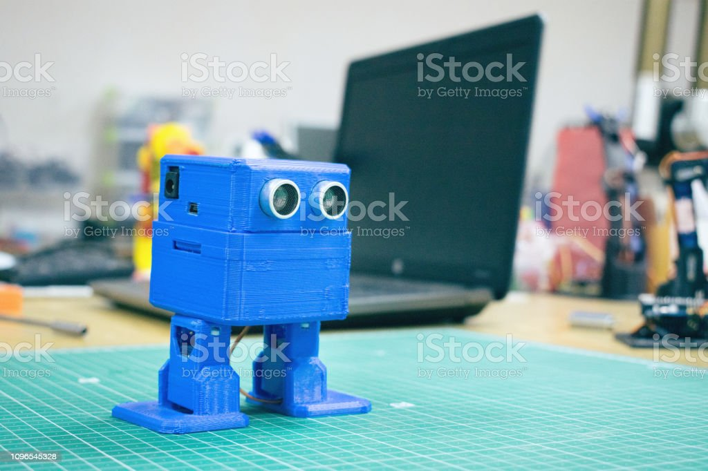 3d Printed Funny Dancing Blue Robot On The Background Of