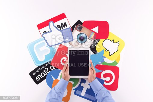 istock Printed Paper Social Media Logos on Desk with User 505770072