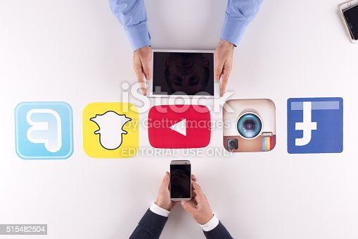 istock Printed Paper Social Media Logos on Desk with User 515482504