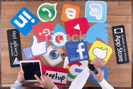 istock Printed Paper Social Media Logos on Desk with Users 503336044