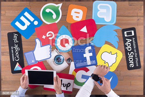istock Printed Paper Social Media Logos on Desk with Users 503516012