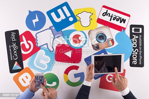 istock Printed Paper Social Media Logos on Desk with Users 506515242