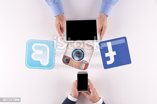 istock Printed Paper Social Media Logos on Desk with Users 507247988