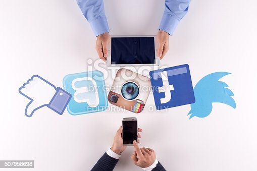 istock Printed Paper Social Media Logos on Desk with Users 507958698