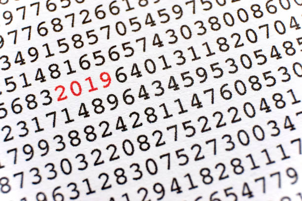 Printed random numbers and the number 2019 in red stock photo