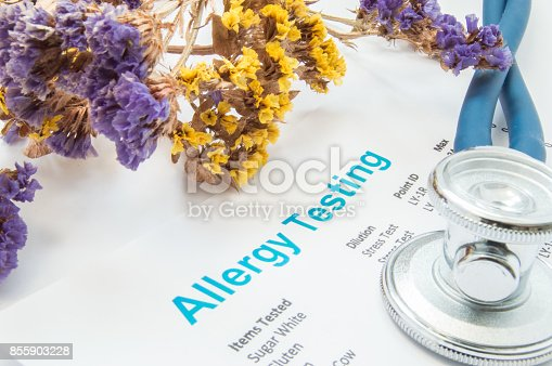 istock Printed result of allergy test (blood or skin) lies next to flowers with falling pollen and stethoscope. Concept photo for analysis of presence allergies to food, pollen, hair or wools in human 855903228