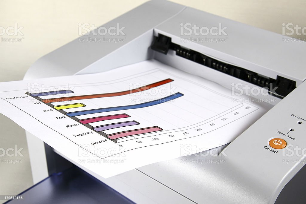 Printed sales report and laser printer stock photo