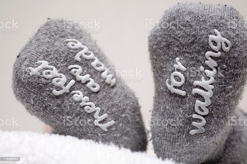 printed text at the bottom of grey baby socks royalty-free stock photo