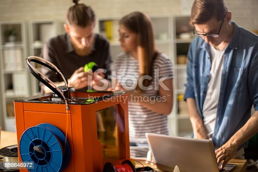 886646936 istock photo 3D Printer in Modern Design Studio 886646972