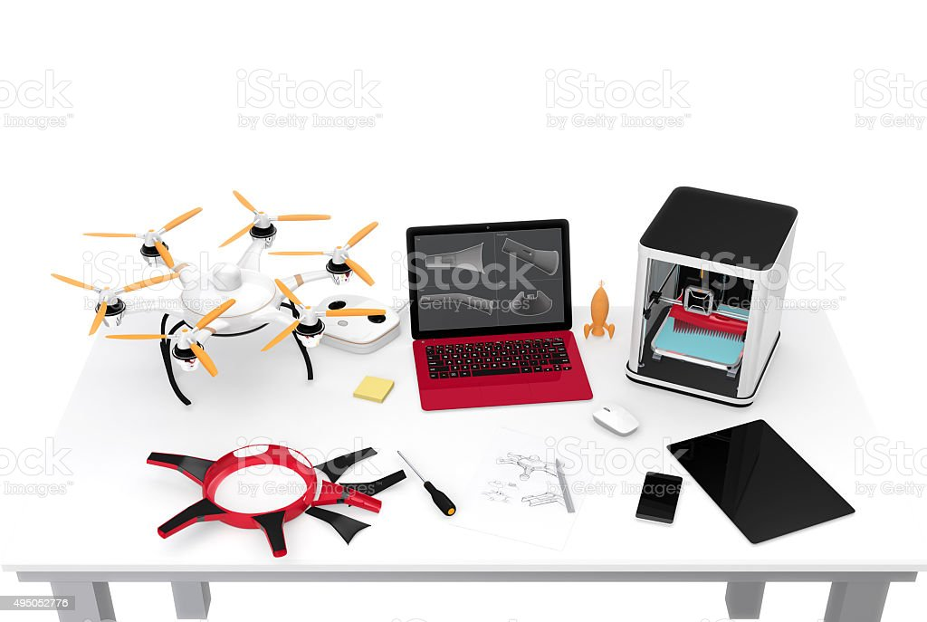 3D printer, laptop, tablet PC and drone on a table, stock photo