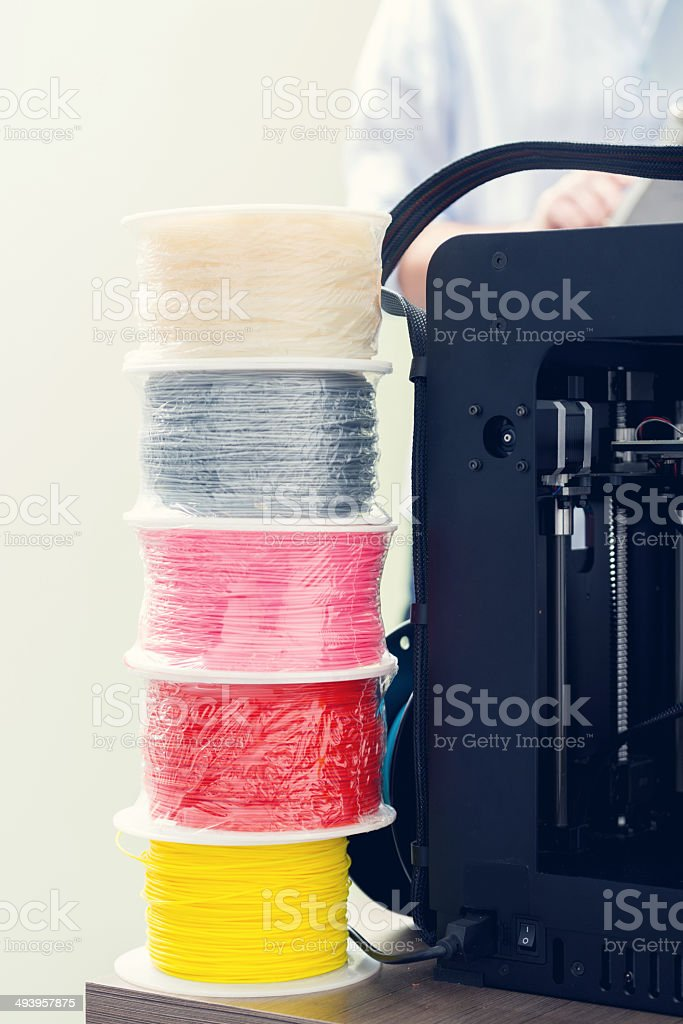 3D printer office Close up of colorful filaments and 3d printer. 3D Printing Stock Photo