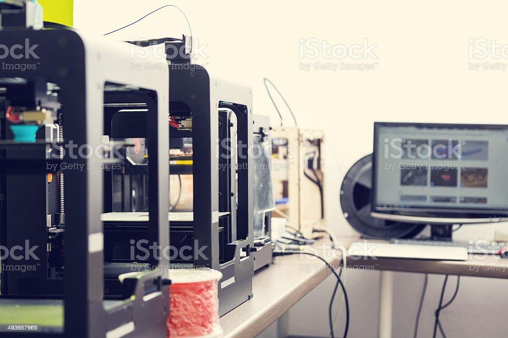 3D printer office Close up of 3d printer machines. 3D Printing Stock Photo