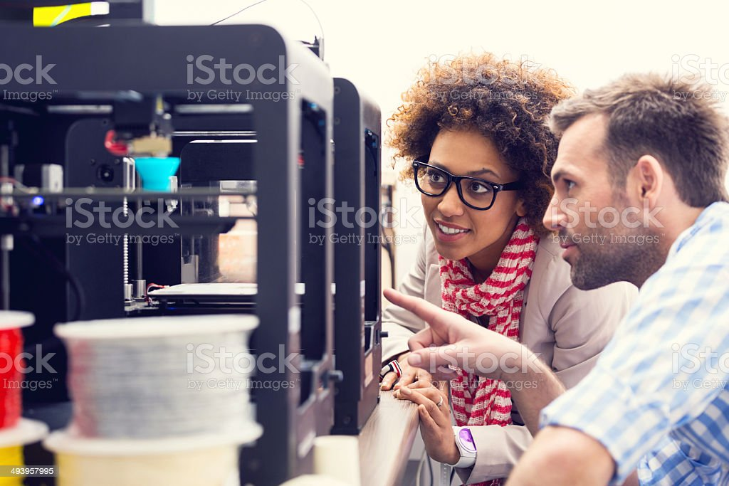 3D printer office Two business colleagues working together in a 3d printer office. 3D Printing Stock Photo