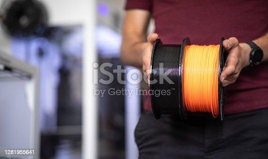 istock 3D Printer Plastic filament for 3D printer 1281955641