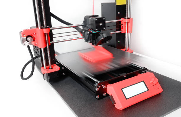 3D printer printing a plastic object with colored filament. New generation of 3D Printing Machine stock photo