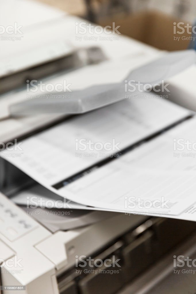 Printer printing out A4 sheets for customer order.