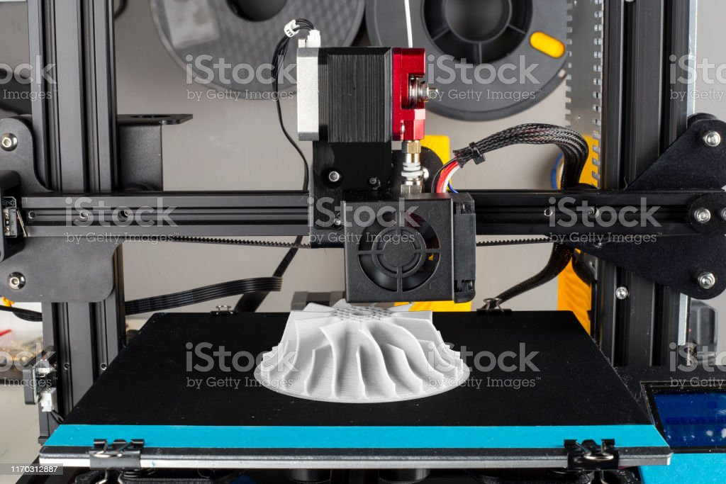 3D printer printing out an compresser wheel model for turbo charger