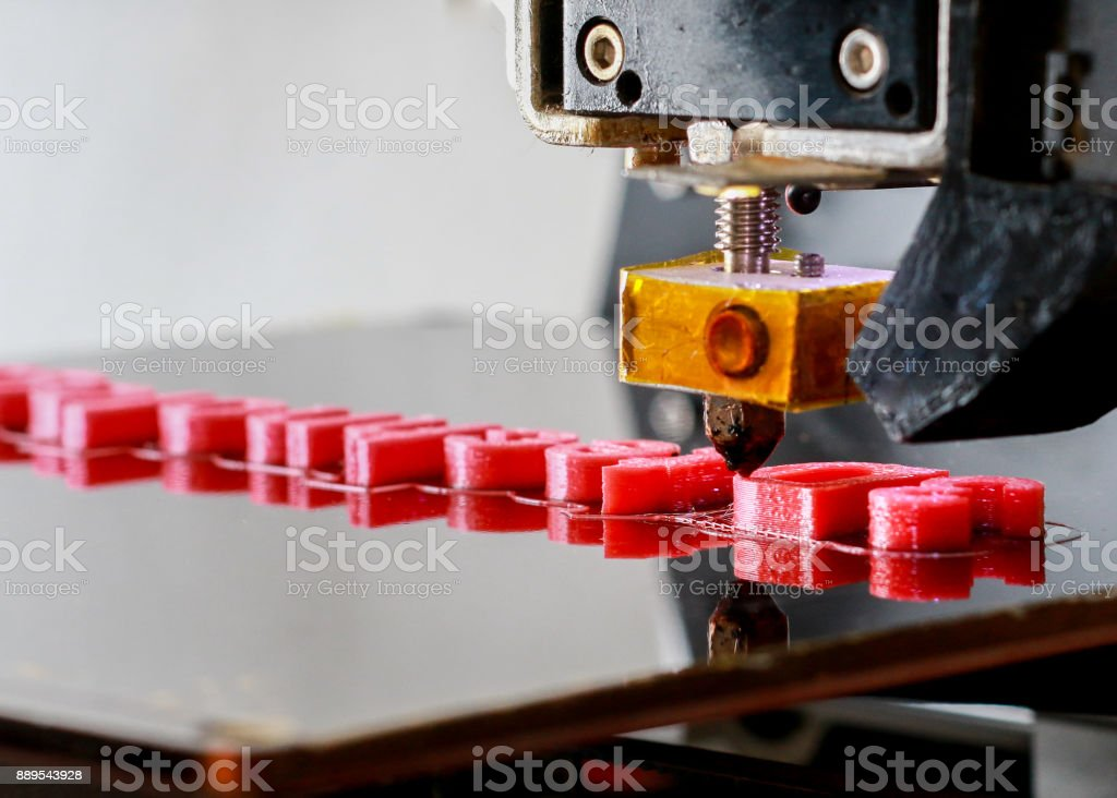 3D Printer printing red letters close up stock photo