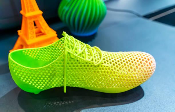 3D printer printing shoe figure stock photo