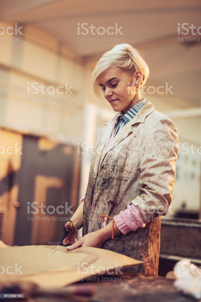Printing and etching -  talented woman is making etching artworks stock photo