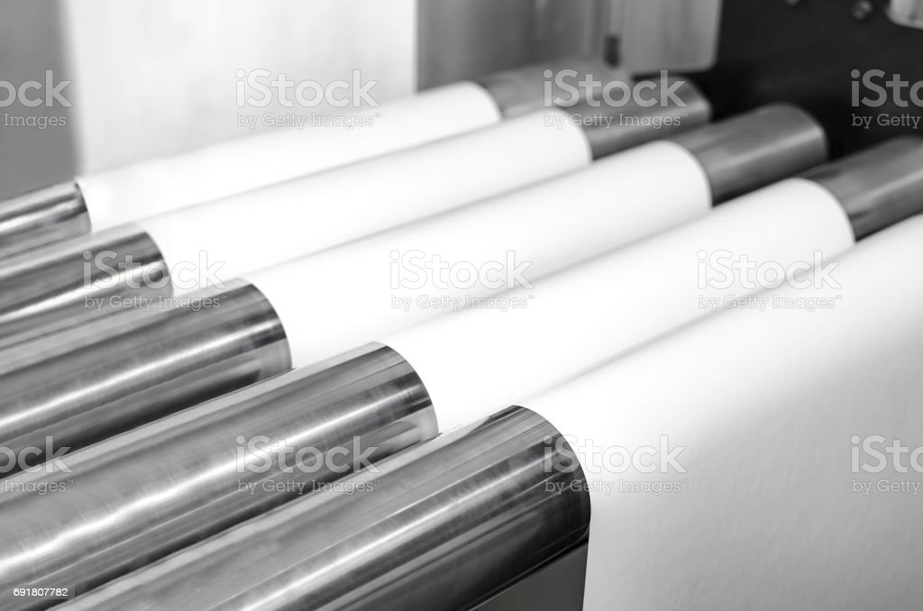 Printing at high speed on offset machine. Label, Rolled Up, Printing Out, Group of Objects, Merchandise stock photo