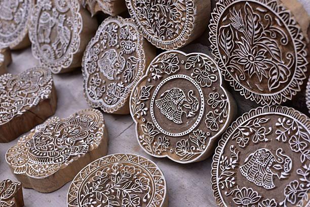printing block stamp for textile design - pfau bilder stock-fotos und bilder
