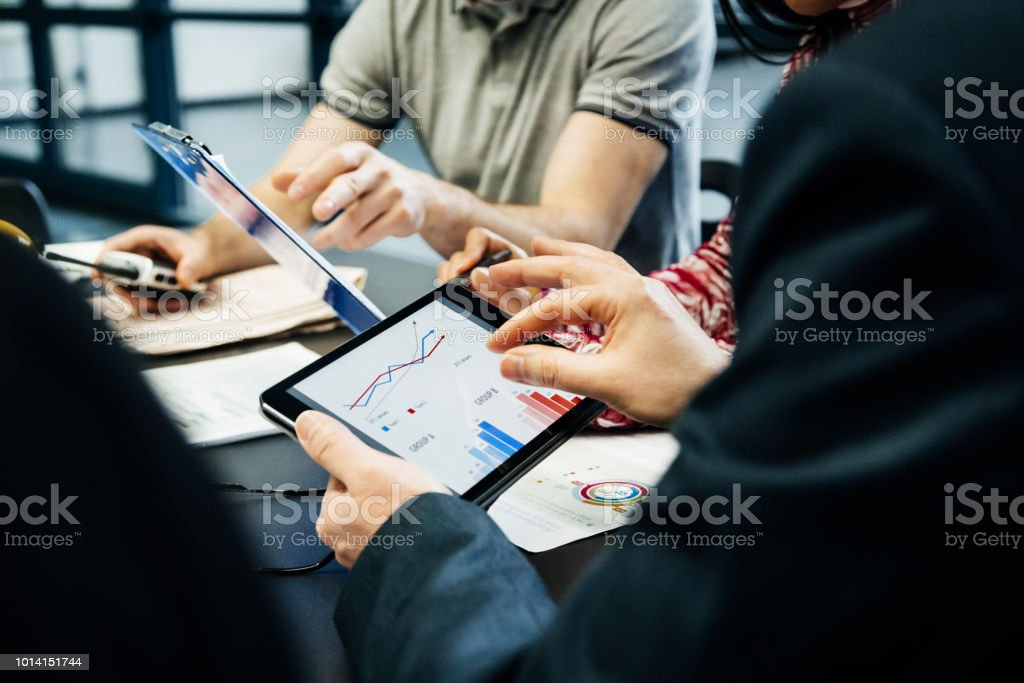 Printing Factory Management Team Holding Meeting - Foto stock royalty-free di Adulto